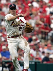ST. LOUIS - APRIL 23:  Scott Rolen #27 of the St. Louis Cardinals throws to first base against  the Chicago Cubs at Busch Stadium on April 23, 2006 in St. Louis, Missouri. The Cubs defeated the Cards 7-3.