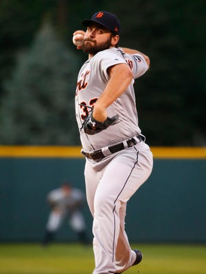 Detroit Tigers starting pitcher Michael Fulmer throws against the Colorado Rockies during the first inning.