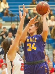 Male center Cameron Browning shoots over Sacred Heart
