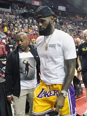LeBron James attends an NBA summer league game between the Lakers and Pistons at the Thomas & Mack Center on Sunday.