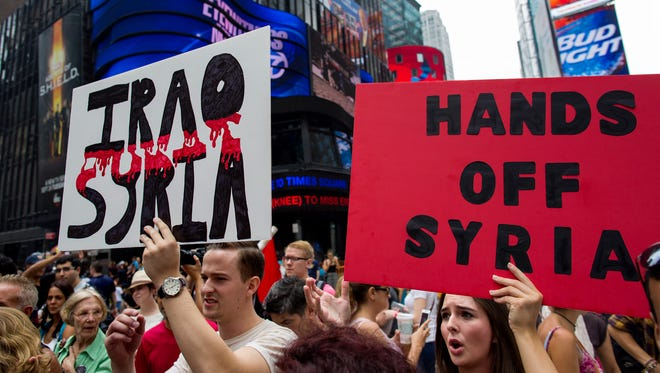 Opponents of U.S. military action in Syria protest Saturday at New York's Times Square.