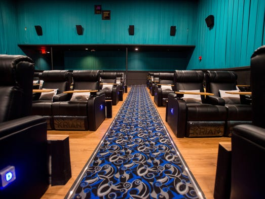 The new carpet, flooring, walls and seating are seen