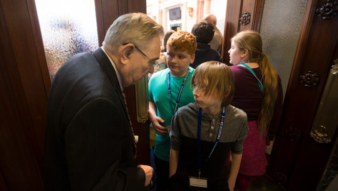 Tom Burch greeted school kids leaving the Kentucky House of Representatives chamber after a tour. Burch is the longest serving member of the General Assembly, at 45 years. March 8, 2017.