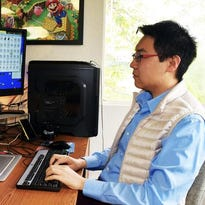"""Serenity Forge founder Zhenghua """"Z"""" Yang works in his office"""