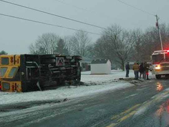 A school bus, not carrying children, overturned Friday