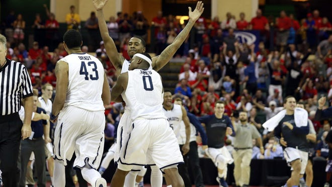 Monmouth Hawks guard Josh James (0) and center Chris Brady (43) and teammates celebrate as they beat the Notre Dame Fighting Irish at ESPN Wide World of Sports Complex. Monmouth beat Notre Dame 70-68. Mandatory Credit: Kim Klement-USA TODAY Sports
