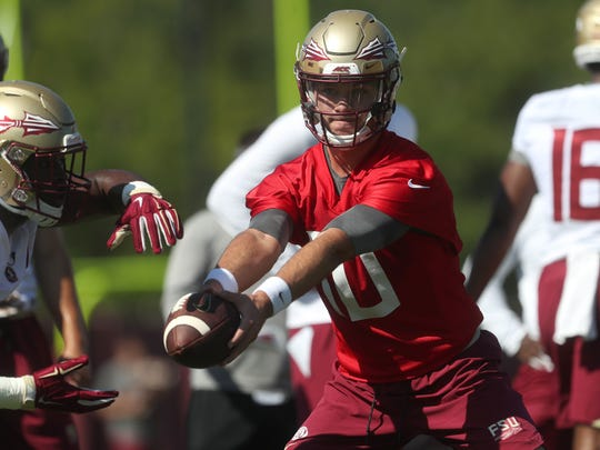 FSU's Bailey Hockman hands the ball off to Jacques