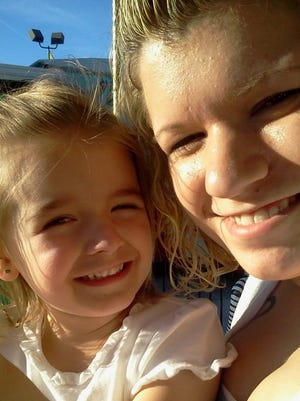 Stephanie Burns with her daughter, Katelyn, before Burns died in a boating accident in June 2013.