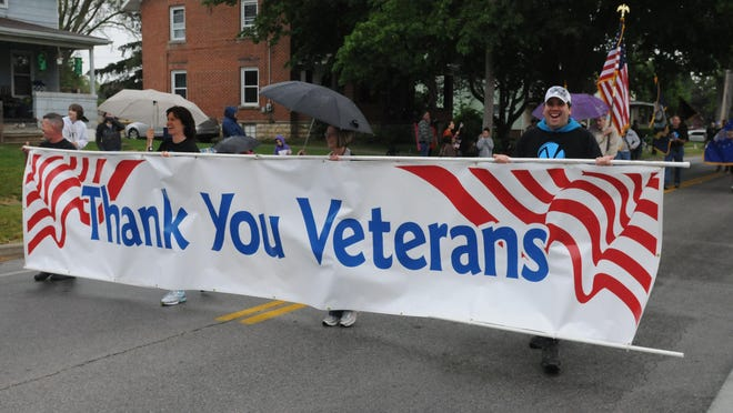 Members of Victory Church in Fremont march with a sign thanking veterans during the Memorial Day parade in Fremont in 2013.