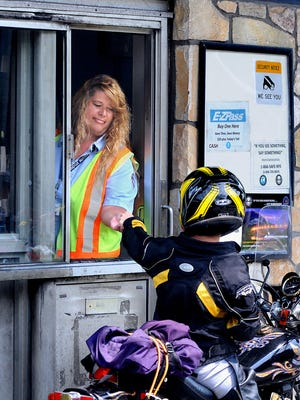 Priscilla Wilklow, 51, left, senior toll collector on the Mid-Hudson Bridge in Highland, has worked for the New York State Bridge Authority for 27 years. Wilklow collects money from 100 to 300 cars per hour depending on the time of day.