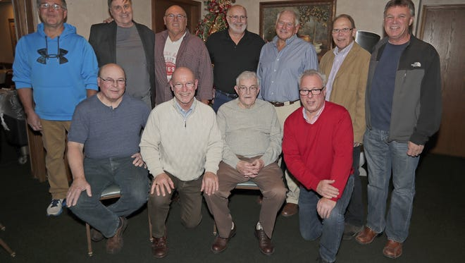 East High School 1969 championship football team reunion at The Rite Place Friday, November 24, 2017 in Bellevue, Wis. Front from left are Ken Kox, Dennis Schoenebeck, coach Bob Boyle, Bob Fisher. Back from left are, Bob Joepeck, Mike Harrington, Bruce Steinfeldt, Mike Brice, Bob De Keyser, Jeff Dobratz and Tom Green.
