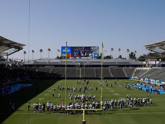 Los Angeles Chargers and Los Angeles Rams players gather on the field for a joint practice during NFL football training camp at StubHub Center, Saturday, Aug. 5, 2017, in Carson, Calif. (AP Photo/Jae C. Hong)