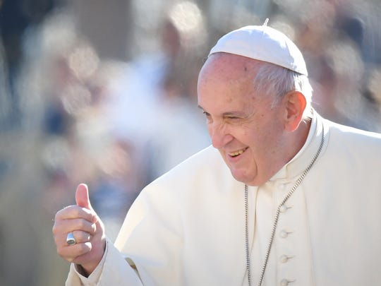 Pope Francis gestures to worshipers as he arrives for the weekly general audience on October 9, 2019 at St. Peter's Square in the Vatican. (Photo by Alberto PIZZOLI / AFP) (Photo by ALBERTO PIZZOLI/AFP via Getty Images)