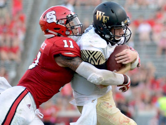 North Carolina State safety Josh Jones tackles Wake