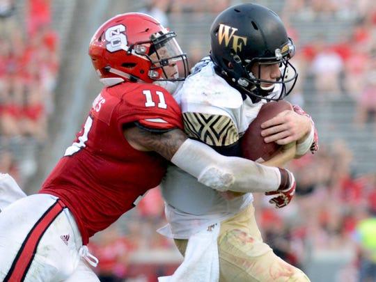 North Carolina State safety Josh Jones tackles Wake