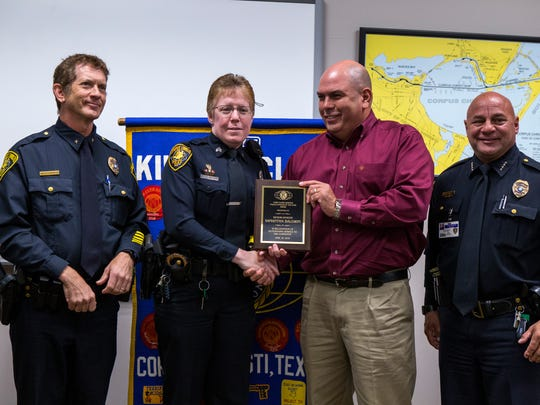 Corpus Christi Police Asst. Chief Mark Schauer (from left), Senior Officer Samantha Baldwin, Mike Silva, president of the Corpus Christi Chapter of Kiwanis Club International, and Police Chief Mike Markle gather as Baldwin is presented with the club's Police Officer of the Year award at the Congressman Solomon P. Ortiz International Center on Thursday, April 26, 2018.