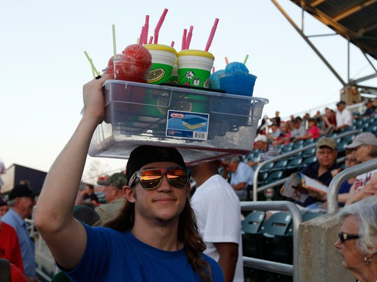 Vendor Matthew Less peddles snow-cones and lemonade at Hammond Stadium Thursday in Fort Myers.