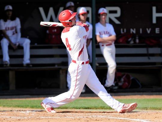 Albany shortstop Brian Hamilton (4) follows through