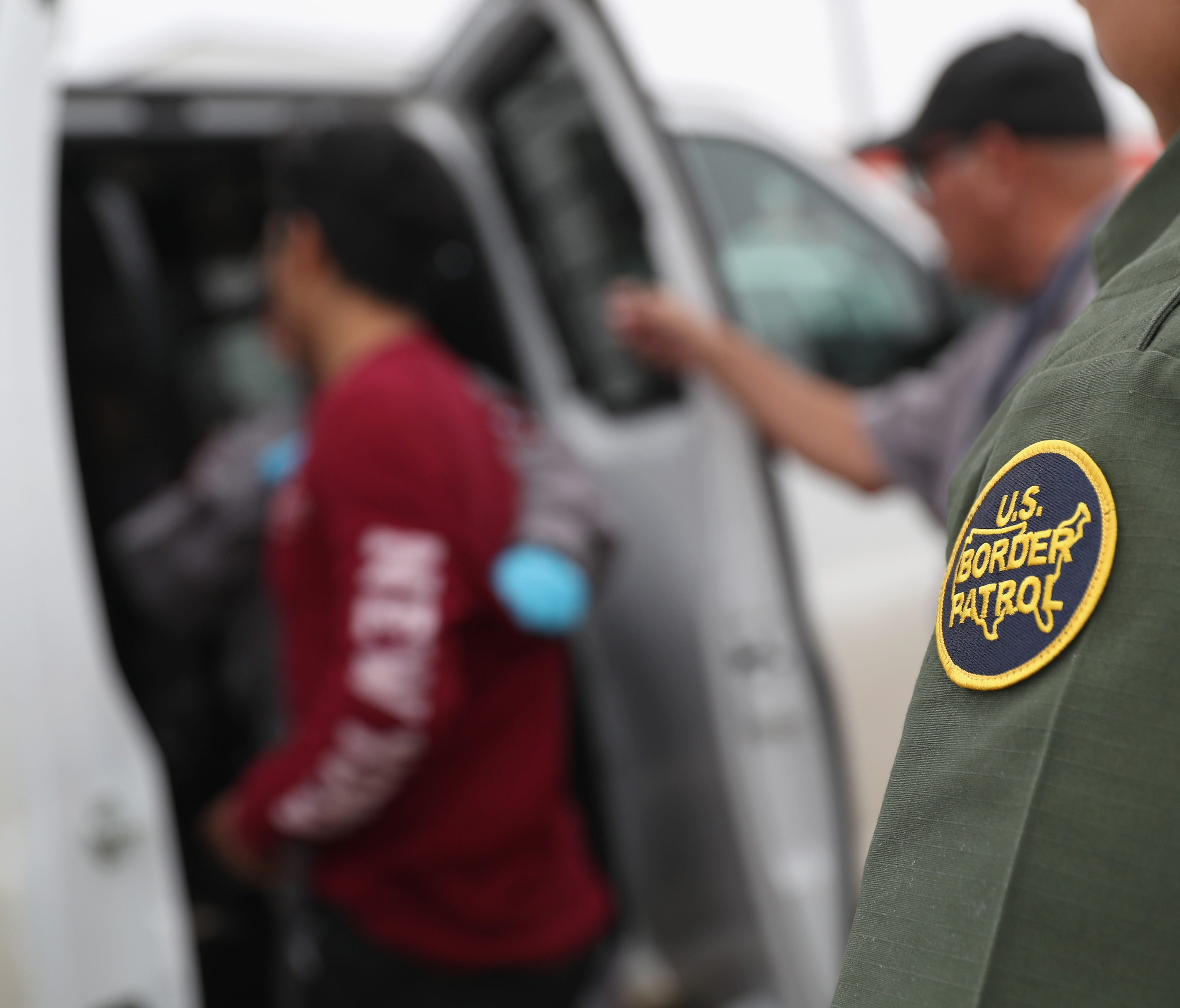 U.S. border agents detain an undocumented immigrant caught near the U.S.-Mexico border March 13, 2017 in Roma, Texas.