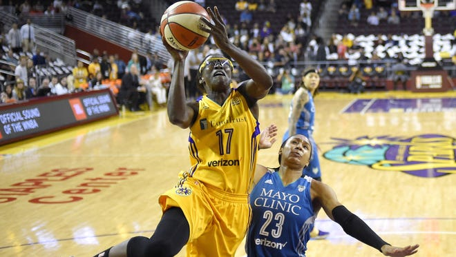 Los Angeles Sparks forward Essence Carson, left, shoots as Minnesota Lynx forward Maya Moore defends during the first half Friday in Game 3 of the WNBA Finals in Los Angeles.