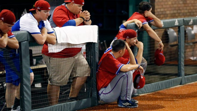 Louisiana Tech players show their disappointment at losing their NCAA Regional Baseball Tournament championship game to Mississippi State, 4-0, at Dudy Noble Field in Starkville, Miss., Sunday, June 5, 2016. (AP Photo/Rogelio V. Solis)