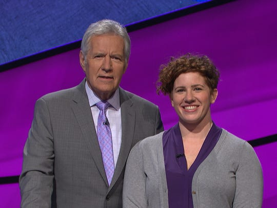 Jeopardy host Alex Trebek with Skyler Kelemen, a 2004