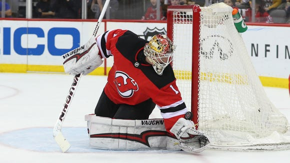 New Jersey Devils goaltender Keith Kinkaid (1) makes a save during the first period of their game against the Pittsburgh Penguins at Prudential Center.