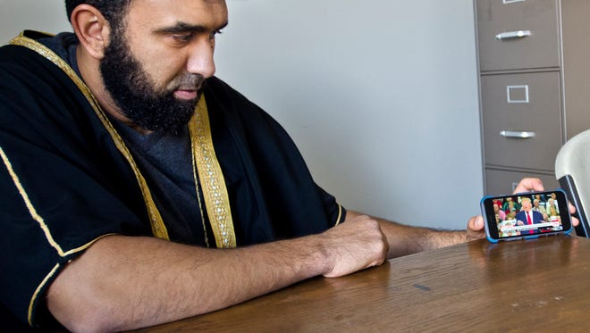 Islam Hassan watches a video of republican presidential candidate Donald Trump on CNN. Hassan, the Iman at the Islamic Society of Vermont, said Trump has insulted multiple groups including women and people with disabilities and now Muslims. American Muslims in Vermont should go about their daily lives without fear, he said.