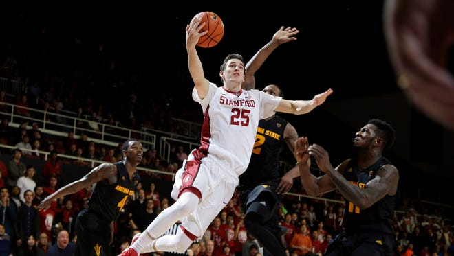 Stanford forward Rosco Allen (25) drives to the basket to make the game-winning shot in the final seconds of an NCAA college basketball game against Arizona State Saturday, Jan. 23, 2016, in Stanford, Calif. Stanford won 75-73.