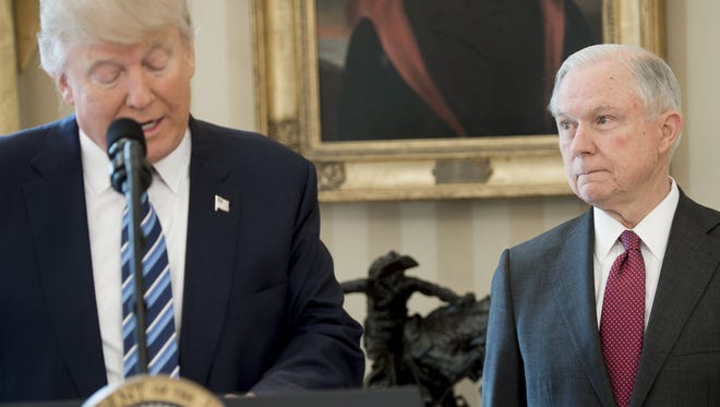 President Trump speaks alongside Attorney General Jeff Sessions after Sessions was sworn in as attorney general in the Oval Office on Feb. 9, 2017.