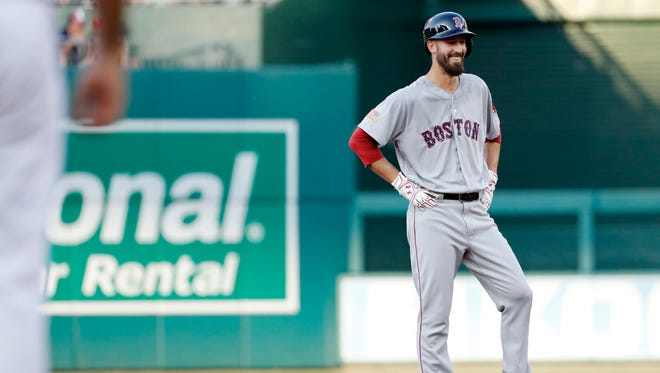 Boston Red Sox starting pitcher Rick Porcello (22) smiles while standing on second base after hitting a three-run double against the Washington Nationals in the second inning at Nationals Park.