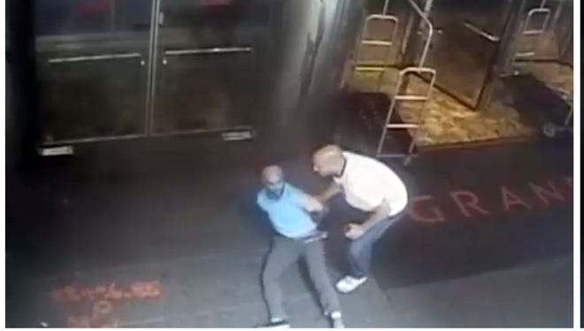 The image taken from a surveillance camera and released by the New York Police Department shows former tennis star James Blake being arrested by plainclothes officer James Frascatore outside of the Grand Hyatt New York hotel on Sept. 9, 2015.