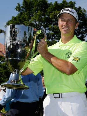 Jerry Smith holds the trophy after winning the Encompass Championship golf tournament Sunday, July 12, 2015, in Glenview, Ill.