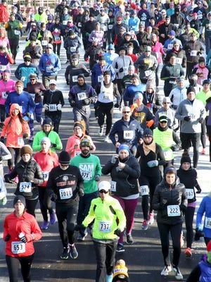 Racers start the 5K during the 2017 Samson Stomp at the Milwaukee County Zoo. This year's event is set for Jan. 14.