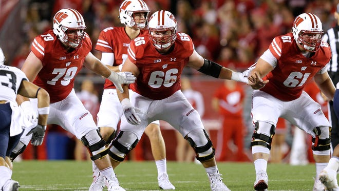 Wisconsin offensive lineman David Edwards (79), offensive lineman Beau Benzschawel (66) and offensive lineman Tyler Biadasz (61) provide pass protection during a game earlier this season.