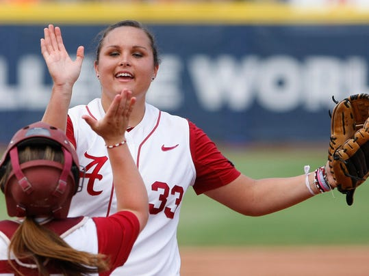 Alabama pitcher Jaclyn Traina, top, high-fives catcher Molly Fichtner between innings against Oregon during an NCAA Women's College World Series softball tournament game in Oklahoma City, Sunday, June 1, 2014. (AP Photo/Alonzo Adams)