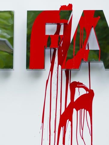 Activists defaced a FIFA sign at near its headquarters