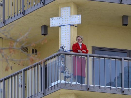 The lighted cross on Lorraine Peressini's 7th floor