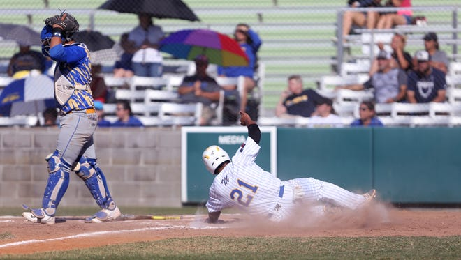 Moody's Ramsey Flores slides into home in the first inning of the game against Pharr Valley View at Cabaniss on Saturday, May 13, 2017.