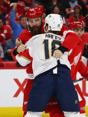 Red Wings forward Luke Witkowski fights the Panthers' Micheal Haley during the first period on Monday, Dec. 11, 2017, at Little Caesars Arena.