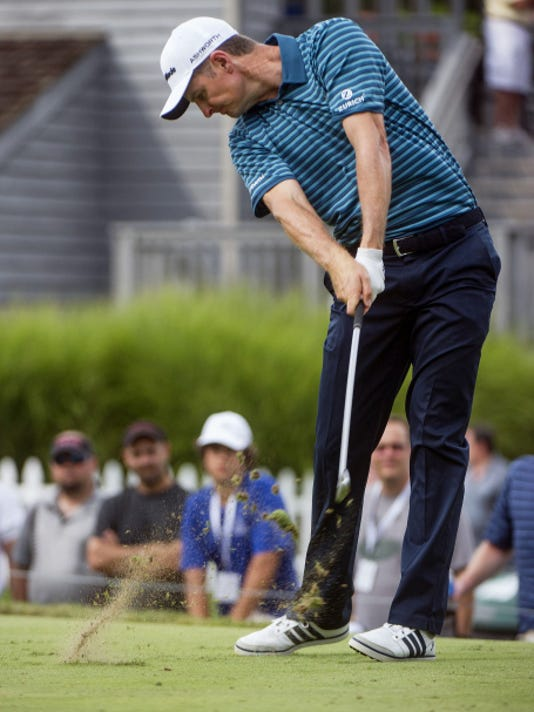 Justin Rose hits his tee shot on the 17th hole during the third round of the Bridgestone Invitational golf tournament Saturday in Akron, Ohio. Rose recorded a 63 to grab a share of the lead with Jim Furyk.