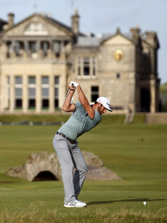 Dustin Johnson drives a ball from the 18th tee during the second round of the British Open at the Old Course in St. Andrews, Scotland, on Saturday.