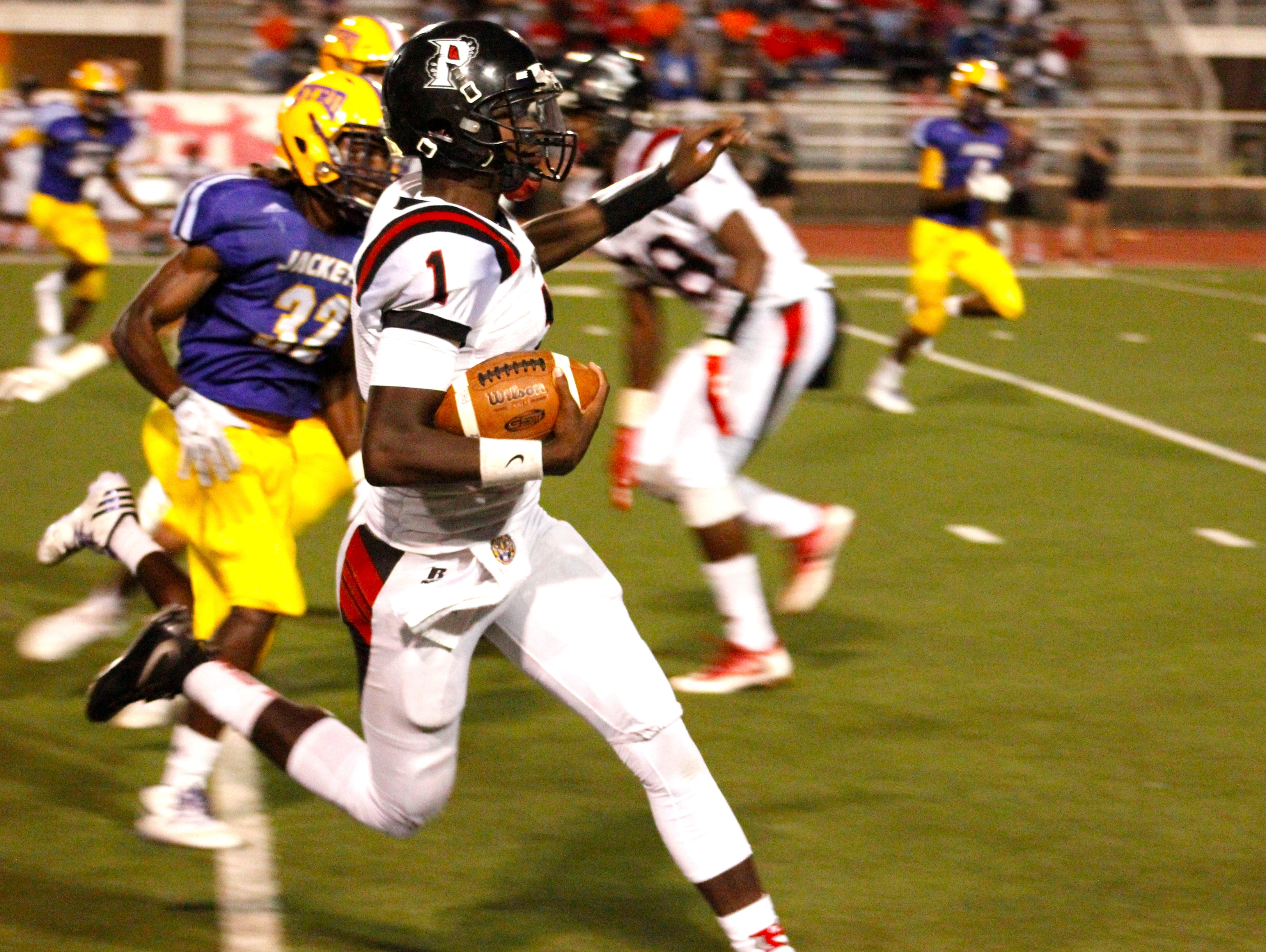 Parkway's Justin Rogers runs for yardage earlier this season against Byrd. Rogers finished second in the state in passing yards.