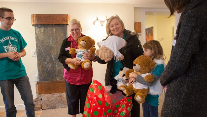 Debbie Heisler and her granddaughter Mariah deliver teddy bears to the Erin Kimball Foundation in Washington Wednesday, Dec. 14, 2016.