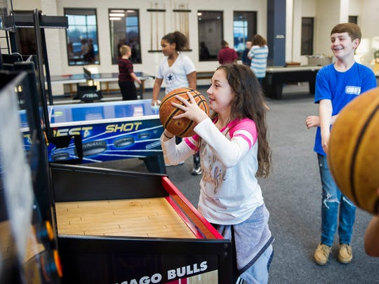 Alyse Rollings, 10, left, and Thomas Knight, 14, both of Henderson, play arcade games at the Henderson County Family YMCA, Tuesday, Jan. 24. 2017. In 2016, the Henderson County Family YMCA offered financial assistance services to 3,874 people for a value of $421,758.