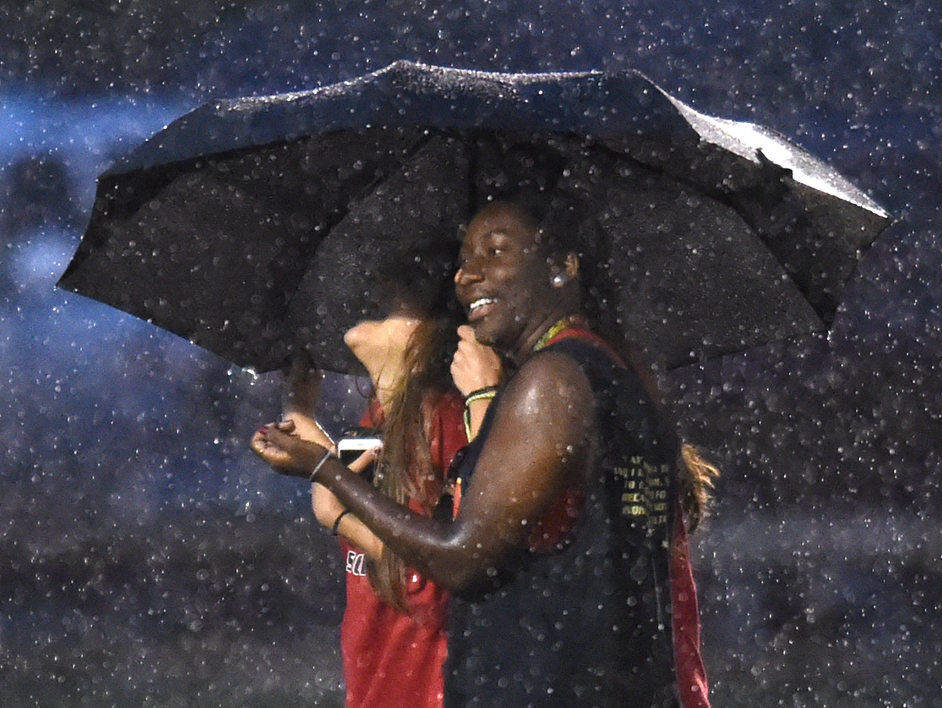 Spectators laugh while taking cover in a lightning delay at Richard Siegel Soccer Complex during Spring Fling Wednesday, May 25, 2016 in Murfreesboro, Tenn.