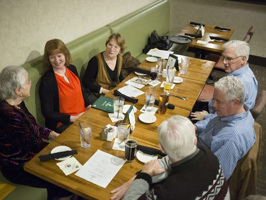From bottom: Couples Jean and Curtis Williams, Marianne and Bruce Harbold, and Darlene and Charles Welter, chat during the gathering. Jean Williams, Marianne Harbold and Darlene Welter, who became friends during jury duty twenty years ago, gather at Knickers Pub at Heritage Hills Golf Resort in Springettsbury Township.