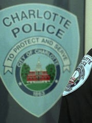 A woman who was shot by police in Charlotte is recovering and could face criminal charges.
