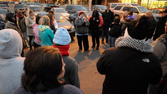 A group of searchers meets in the Kroger parking lot on East Main Street in Lancaster. About 40 people gathered Monday night to search for Terri Jo Hamm, who has been missing since Jan. 26.