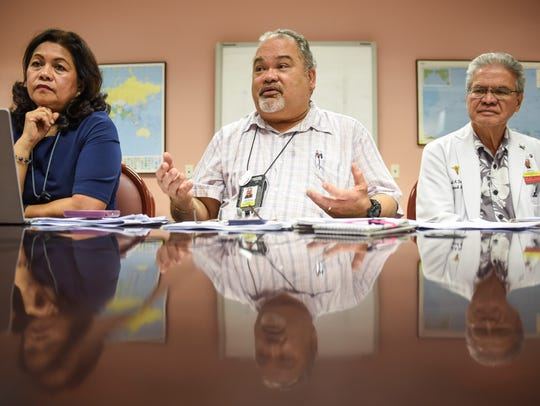 In this June 12 file photo, PeterJohn Camacho, center, Guam Memorial Hospital administrator, is flanked by GMH Chief Financial Officer Benita Manglona, left, and GMH Medical Director Dr. Vincent Duenas, as he addresses allegations of mismanagement during a press conference.